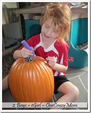 Decorating a pumpkin with paint 2