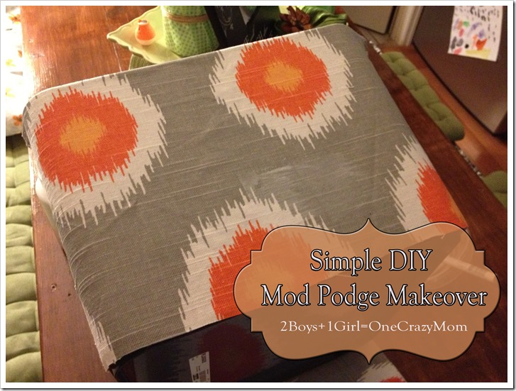 lay your fabric on top of the mod podge glue and smooth it out